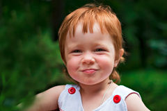 Portrait of a funny red-haired girl stock images