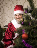 Portrait of funny Santa Claus. At Christmas tree Stock Image