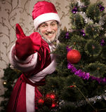 Portrait of funny Santa Claus. At Christmas tree Royalty Free Stock Photography