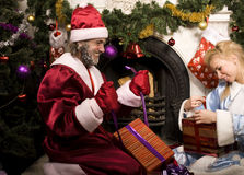 Portrait of funny Santa Claus. At Christmas tree Stock Photography