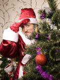 Portrait of funny Santa Claus. At Christmas tree Royalty Free Stock Image