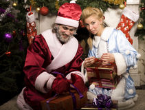 Portrait of funny Santa Claus. At Christmas tree Stock Photos