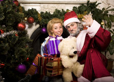 Portrait of funny Santa Claus at home with Royalty Free Stock Photos