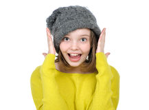 Portrait of a funny teen girl who laughs. Portrait of a funny teen girl who laughs on a white background stock photo