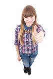 Portrait of funny teenage girl thumbs up isolated on white Royalty Free Stock Image