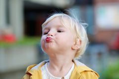 Portrait of funny toddler girl outdoors Stock Image