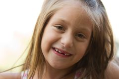 Portrait of funny toothless little girl Stock Photography