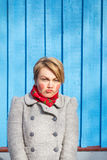 Portrait of funny woman on blue wooden wall, saturated color Royalty Free Stock Photo