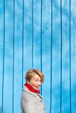 Portrait of funny woman on blue wooden wall, saturated color Royalty Free Stock Image