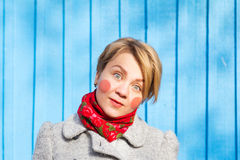 Portrait of funny woman on blue wooden wall, saturated color Stock Image