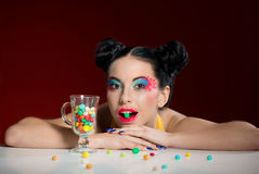 Funny girl with candy drops stock photos