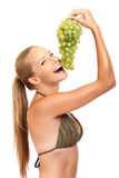 Portrait of a funny woman with grape Royalty Free Stock Photos