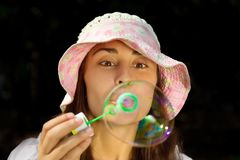 Portrait of a funny young girl blowing bubbles Stock Image