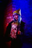 Portrait of funny zombie girl in halloween time Royalty Free Stock Image