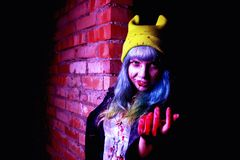 Portrait of funny zombie girl in halloween time Stock Images