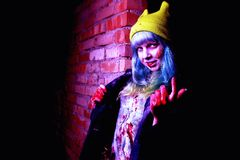 Portrait of funny zombie girl in halloween time Stock Photo