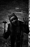 Portrait of funny zombie girl in halloween time with hammer Stock Photos