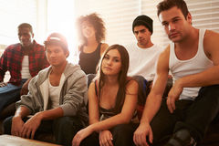 Portrait Of Gang Members Sitting On Sofa In House royalty free stock image