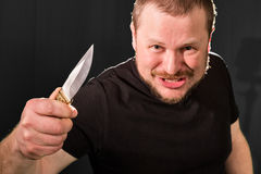 Portrait of a gangster with a knife Royalty Free Stock Image