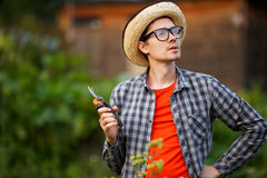 Portrait of gardener young man holding pruning sheers outdoors Royalty Free Stock Photo