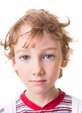 Curly boy face in close-up Royalty Free Stock Photos