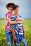 Portrait of gay couple in love on daisy summer field Stock Photo