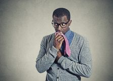 Portrait geeky nervous anxious man bitting chewing his tie Royalty Free Stock Image