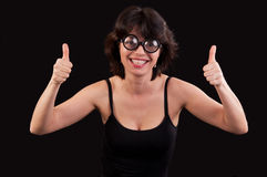 Portrait of a geeky  young woman with double thumbs up Stock Photography