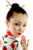 Portrait of geisha. Portrait of the girl of the Asian appearance, with a make-up under the geisha, on a white background Stock Images