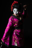 Portrait of geisha dancing with sword Royalty Free Stock Photography