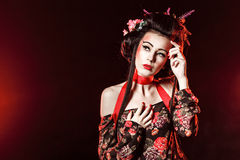 Portrait of a Geisha with hair and makeup. Stock Photography