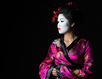 Portrait of geisha looking on copy space Royalty Free Stock Photo