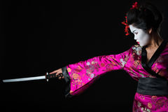 Portrait of geisha warrior with sword Royalty Free Stock Photos