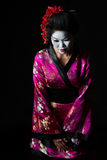 Portrait of geisha welcome with respect. Isolated on black Stock Images