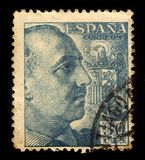 Portrait of General Franco with Coat of Arms. SPAIN - CIRCA 1940: a stamp printed in Spain shows portrait of General Francisco Franco, ruled over Spain as a royalty free stock photography