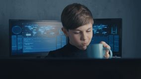 Genius boy wonder hacks system at cyberspace. Cute kid young programmer working on computer at data center.