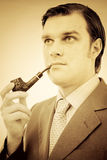 Portrait of a gentleman smoking pipe Royalty Free Stock Photo