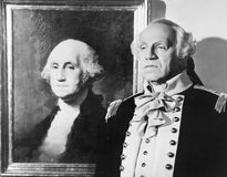 Portrait of George Washington with an impersonator next to the image Royalty Free Stock Photos