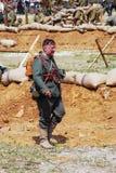 Portrait of a German soldier-reenactor walking on the battle field. Stock Photography