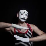 Portrait of gesticulating mime. On black background Royalty Free Stock Image