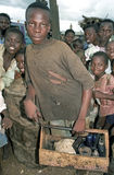 Portrait Ghanaian shoeshine boy with shoe polish. Ghana, Street Child trying on the market of the village Zabreme (north-east of Techiman) to earn some money royalty free stock photo