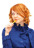 Portrait of ginger-haired girl with pen Stock Image