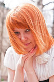 Portrait of a ginger-haired woman Stock Photos
