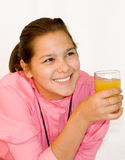 Portrait of girl. The girl drinks orange juice.The photo is made in October 2009 stock photography