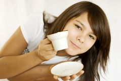 Portrait of girl. The girl drinks orange tea.The photo is made in October 2009 Royalty Free Stock Image