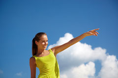 Portrait of the girl. On a background of the dark blue sky with clouds Stock Images
