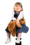 Portrait of a Girl. A sweet 18 months old girl cuddles her toy doggie Stock Image