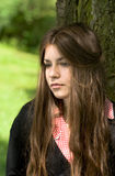 Portrait of a girl. Portrait of attractive girl in the park is thinking or dreaming Stock Photos