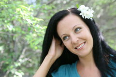 Portrait of a girl. On a background a blooming garden Royalty Free Stock Image