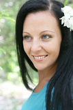 Portrait of a girl. On a background a blooming garden Royalty Free Stock Photo